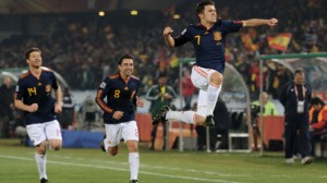 Spain opens defense of their World Cup title against the Netherlands Friday.